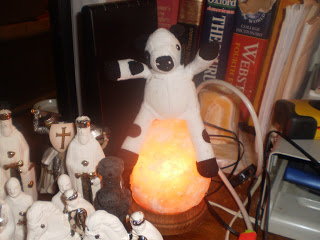 stuffed cow sitting on a lamp